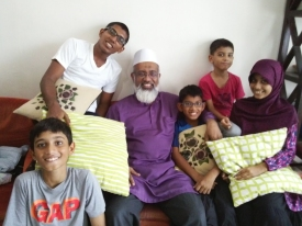 Isaiah and his blissful family are full of smiles.