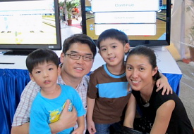 SCOGA Advisor and former national bowler Mike Lam with his family bonding together over a game of Wii Bowling at the Asian Children's Festival 2009.