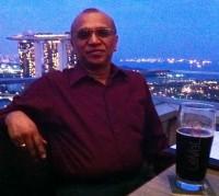 Ms Jaya's father enjoying a drink