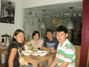 Allan and his family (wife-Linda, daughter-Candida and son-Russell) enjoying a meal together in a restaurant in Washington DC during their family holiday to the States in 2011.