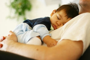 Baby Asleep On His Father'S Chest.
