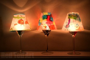 Use your children's art to make lampshades for wine glasses. Photo source: Red Ted Art